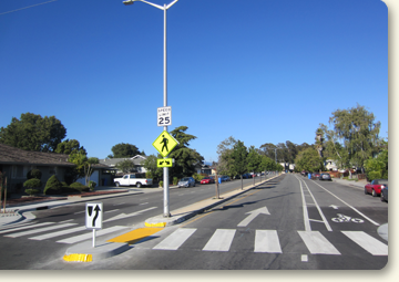 scene of a high-visibility crosswalk and buffered bike lanes